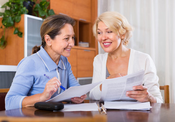 Mature women with documents