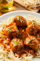 Pasta fettuccine and meatballs with tomato sauce