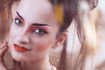 Close up stylized portrait of a Japanese geisha with bright make