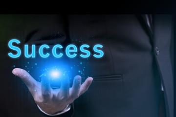 businessman showing success word.marketing concept.