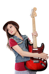 Cool pose of lady rocker with her guitar, isolated on white
