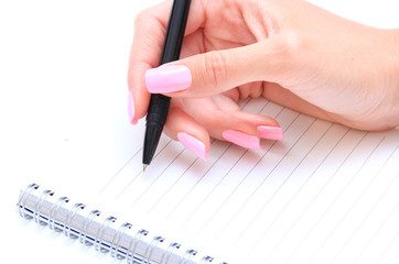 Notebook, pen and female hand