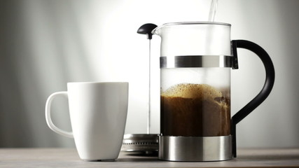 Making coffee with a French press coffee maker