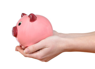 Woman hands holding a pink piggy bank isolated