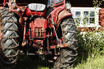 old vintage tractor with snow chains