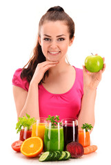 Young woman with variety of vegetable and fruit juices