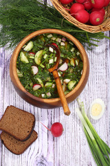 Okroshka with kvass in a wooden bowl