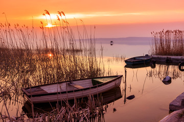 Sunset on the lake Balaton with a boat