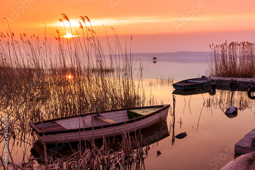 Fotografiet Sunset on the lake Balaton with a boat