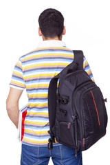 Back view of male student standing on white background