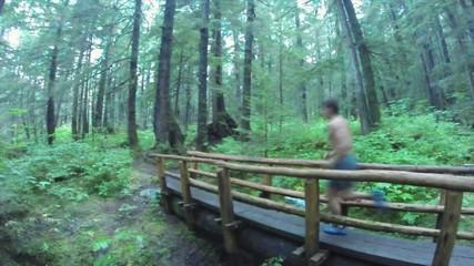 Man running in northwest wilderness