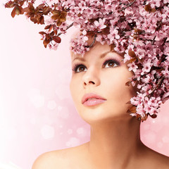 Beautiful Girl With Cherry Blossom isolated. Beauty Woman