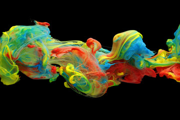 Colorful ink and paint swirling through water