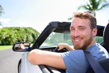 Driving car man happy on road trip travel holidays
