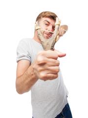 blond man with a slingshot