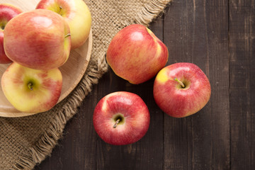 Fresh ripe red apples on wooden background