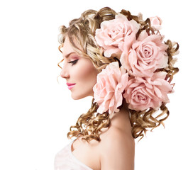 Beauty girl with rose flowers hairstyle isolated on white