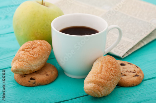 Plakat Morning coffee with sweets and apple on blue wooden table