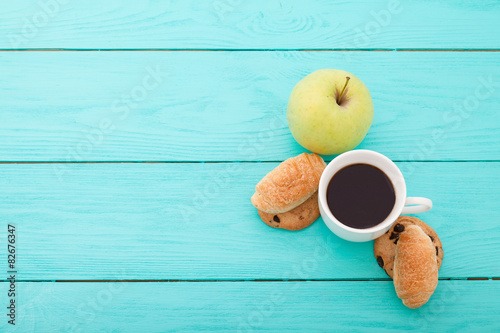 Plakat Breakfast with coffee on blue wooden background