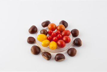 Chestnuts and cherry tomatoes culinary composition