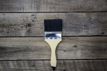new paint brush on the wooden table background