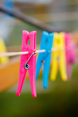 Colorful clothespins on cord after rain on spring