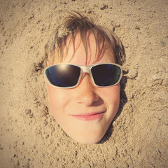 Kid Face in the Sand