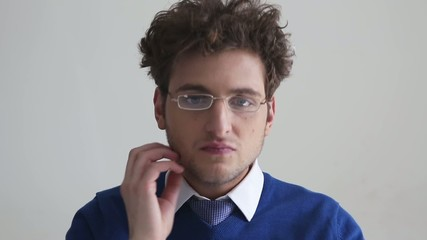 Serious young businessman in glasses