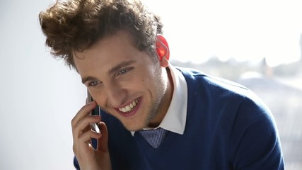 Happy business man talking on the phone