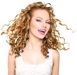Beauty model girl with blowing blonde curly hair