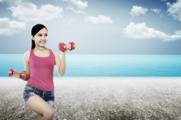 Woman Exercise On The Beach