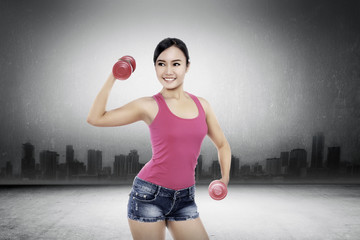 Woman Exercise With Dumbell