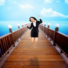 Woman Jumping On The Pier