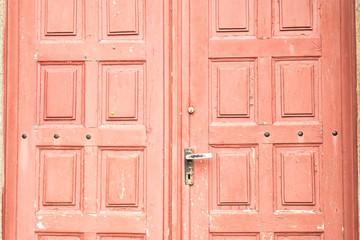 Grunge old barn door in red tones