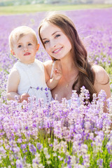 Mother and daughter in field of lavender flowers