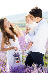 Happy family are resting in lavender field