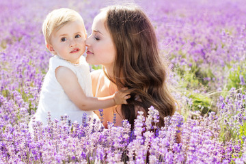 Mother and her girl child in field of lavender