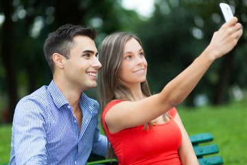 Young couple taking a selfie