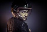 biker with motorcycle helmet and black leather jacket, metal stu