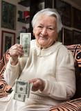 Old woman holding dollar cash money