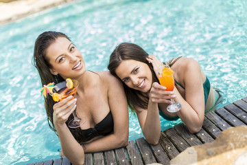 Young women relaxing in the pool
