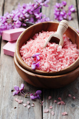 Spa concept with pink salt, soap and flowers