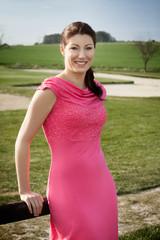 Beautiful brunette on a golf course