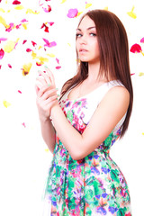Beautiful young woman in a bright many-colored dress