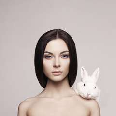 Beautiful woman with rabbit