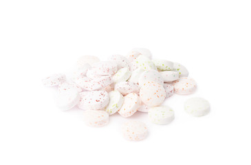 Pile of white breath mint candies isolated
