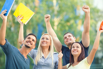 Group of happy students celebrating their success