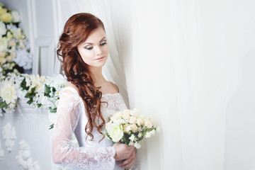 beautiful smiling woman in a wedding dress. Place for text