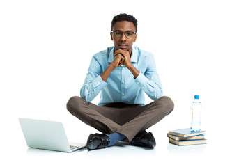 African american college student with laptop, books and bottle o