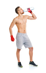 Sport attractive man wearing boxing bandages and drinking fresh